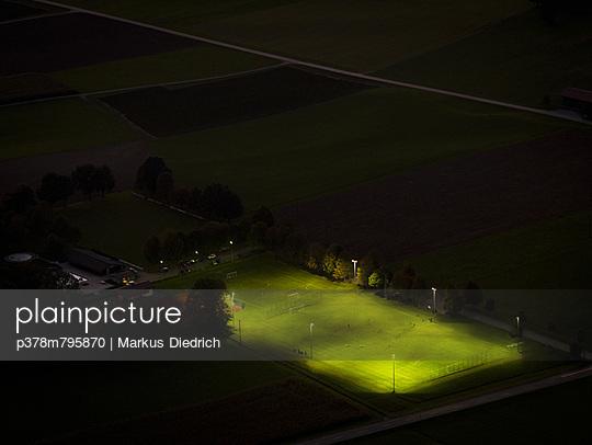 Football field at night - p378m795870 by Markus Diedrich