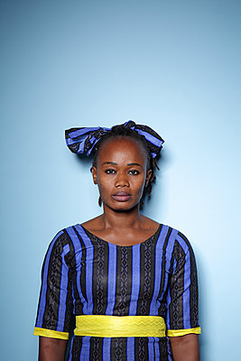 Portrait of a black woman on a blue background - p1540m2100934 by Marie Tercafs