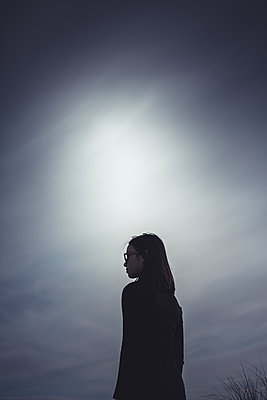 Silhouette of a teenage girl - p1690m2281226 by Marie Carr