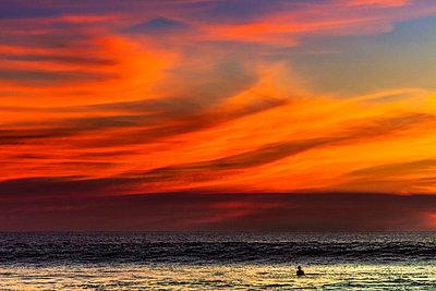 Lone surfer and sunset clouds off Playa Hermosa surf beach, southern Nicoya Peninsula, Santa Teresa, Puntarenas, Costa Rica, Central America - p871m1118663 by Rob Francis