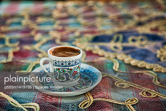 Close up of cup of Turkish coffee - p555m1419735 by Spaces Images
