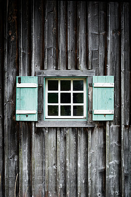 Window of a wooden house - p1149m1124389 by Yvonne Röder
