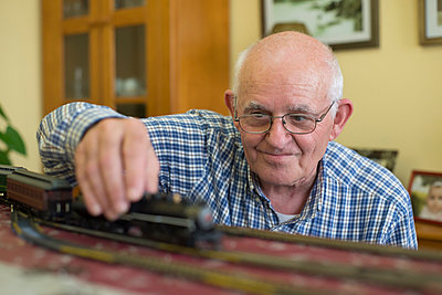 Portrait of smiling senior man with his model railway - p300m1023188f by Ramon Espelt