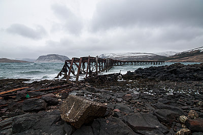 Remains of an old WWII Naval pier - p1047m1087403 by Sally Mundy