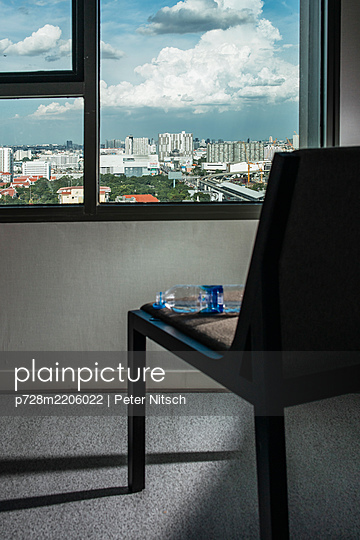 Thailand, Bangkok, Falling water bottle on a chair - p728m2206022 by Peter Nitsch