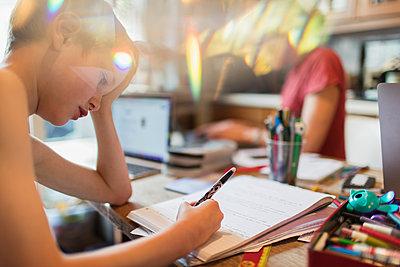 Focused boy homeschooling - p1023m2201020 by Paul Bradbury