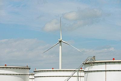 Oil storage and wind turbine in Rotterdam Harbour, Holland - p429m819310f by Mischa Keijser