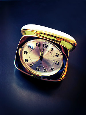 Alarm clock with hands set at 5 to 12 - p597m2182578 by Tim Robinson