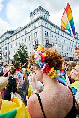 Sweden, Uppland, Stockholm, Vasagatan, Redhead woman at gay pride parade - p352m1349065 by Johan Mård