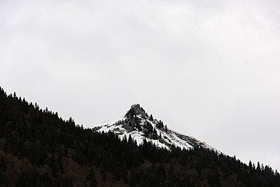 Alpine mountain peak in winter - p1048m1182462 by Mark Wagner