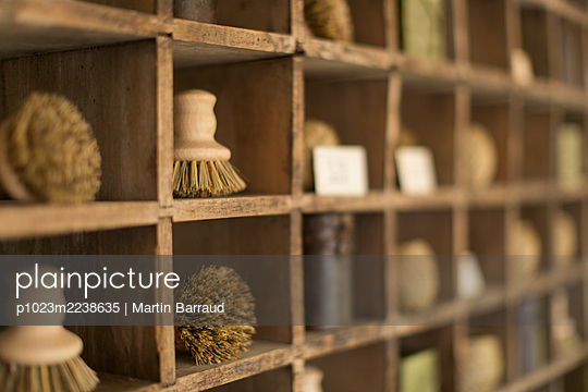 Vintage wooden bristle brushes in wood display cubbies - p1023m2238635 by Martin Barraud