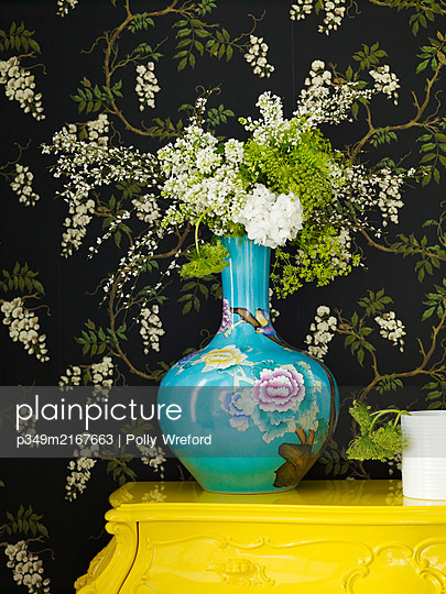 Cut flowers in oriental vase with black floral wallpaper - p349m2167663 by Polly Wreford