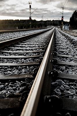 Train track with red signal - p1687m2278476 by Katja Kircher