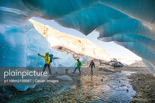 Explorers enter a glacial cave near Vancouver, B.C. - p1166m2159587 by Cavan Images