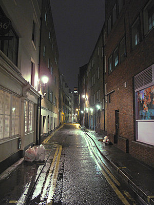 Narrow street in Soho, London - p1072m829267 by Neville Mountford-Hoare
