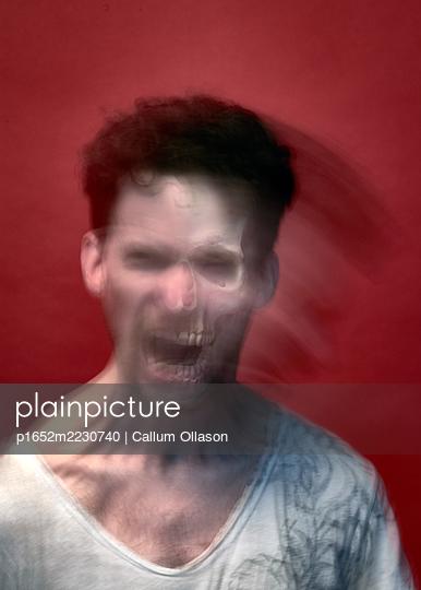 Screaming man, blurred motion - p1652m2230740 by Callum Ollason