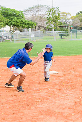 Hispanic coach and young baseball player - p555m1478681 by Kevin Dodge