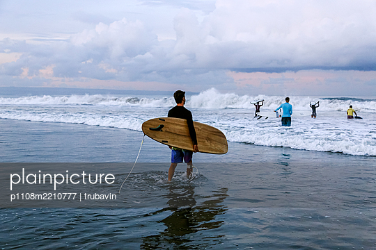 Group of surfers in the surf - p1108m2210777 by trubavin