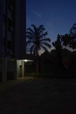 Entrance of a building at night - p1610m2181500 by myriam tirler