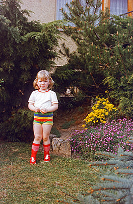 Germany, Girl in the garden in the GDR - p986m2223994 by Friedrich Kayser