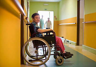 Senior woman sitting in wheelchair in retirement home - p4736580f by STOCK4B-RF