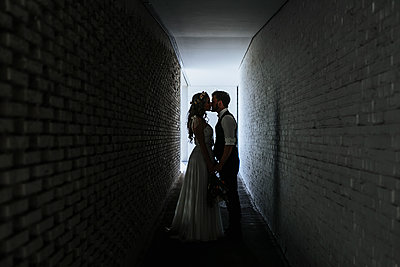 Wedding couple in a tunnel - p680m2177540 by Stella Mai