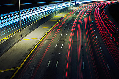 Automobile lights on highway - p9246560f by Image Source