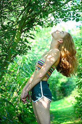 Teenage girl with red hair in the woods - p427m2209801 by Ralf Mohr