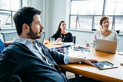 Business people during meeting in office - p1166m1474606 by Cavan Images