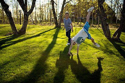 Boys playing in park - p312m1533519 by Fredrik Ludvigsson