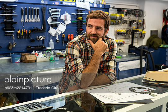 Owner standing in bicycle shop - p623m2214731 by Frederic Cirou