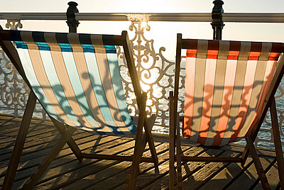 Deckchairs by the sea - p9248448f by Image Source