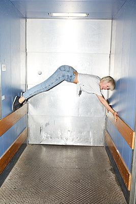 Elevator acrobatics - p276m2115670 by plainpicture