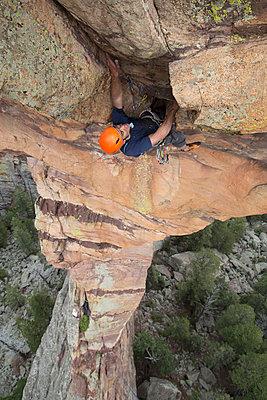 Full length of male hiker rock climbing - p1166m1521822 by Cavan Images