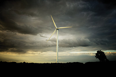 Thunderclouds over single wind turbine - p1462m1516441 by Massimo Giovannini