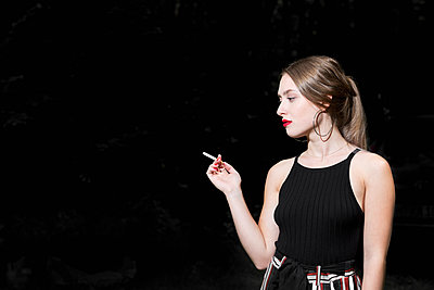 Smoking cigarette - p1149m1584935 by Yvonne Röder