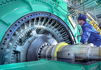 Engineer inspecting generator in nuclear power station during outage - p429m2058271 by Monty Rakusen