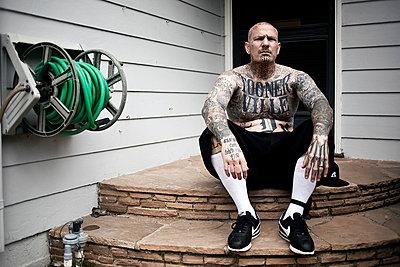 Man with a tattooed skin - p930m814897 by Ignatio Bravo