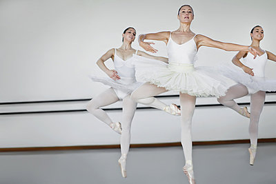 Women in ballet costumes dancing - p42916211f by Hybrid Images