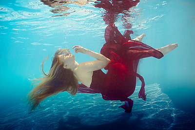 underwater ballet dancer woman  - p1554m2158979 by Tina Gutierrez