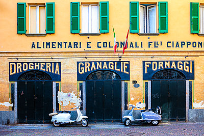 Couple of Lambretta Innocenti scooter parked at the old grocery, Morbegno, province of Sondrio, Valtellina, Lombardy, Italy - p651m2033189 by Roberto Moiola