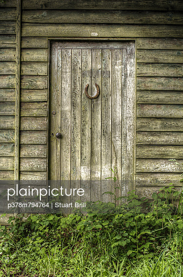 Abandoned shed door - p378m794764 by Stuart Brill