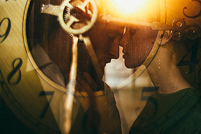 Double exposure of clock and Caucasian couple - p555m1303655 by Sophie Filippova
