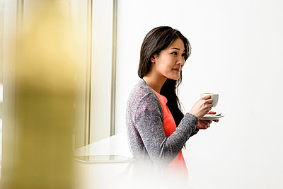Woman having a break - p924m821713f by suedhang photography