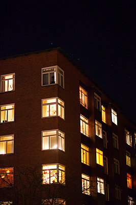 Illuminated block of flats - p312m993158f by Malcolm Hanes
