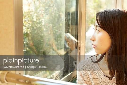 Young Japanese woman on a train - p307m2296746 by Shingo Tosha