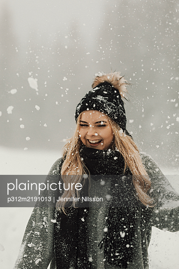 Happy woman at winter - p312m2191013 by Jennifer Nilsson