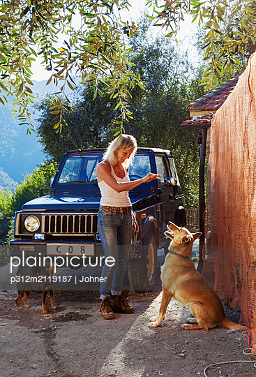 Woman training dog - p312m2119187 by Johner