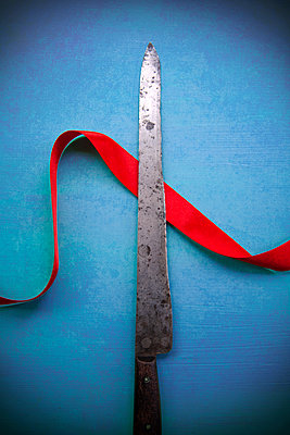Knife Blade with Red Ribbon  - p1248m2108609 by miguel sobreira
