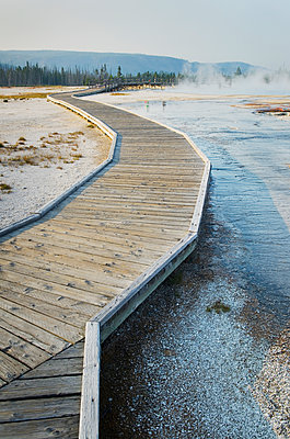 Boardwalk over the hot springs of the Black Sand Basin - p555m1452676 by Spaces Images